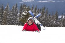 Free Girl Skier Lie On The Snow Royalty Free Stock Image - 24024066