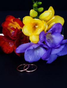 Wedding Rings And A Bouquet Of Freesias Stock Photography