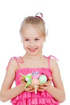 Smiling Girl Holding Easter Eggs In Basket Royalty Free Stock Images