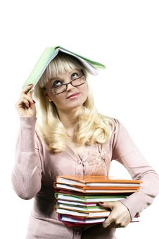Girl Holds A Book On Her Head Stock Photography