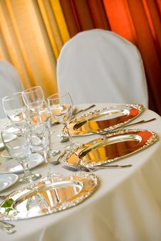 Free A Table Set With Silver Platters Royalty Free Stock Photo - 24044825