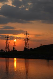 Sunset On The River. Electricity Power Line. Royalty Free Stock Image