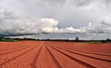 Cloud And Ploughed Royalty Free Stock Photos