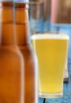 Glass Of Beer And Two Bottles Royalty Free Stock Photos