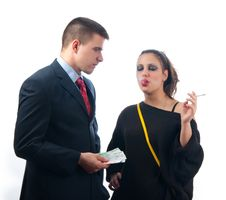 Young Serious Businessman Giving Money To Lady Stock Photography
