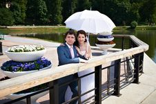 Happy Bride And Groom With Umbrella On Park Royalty Free Stock Photos