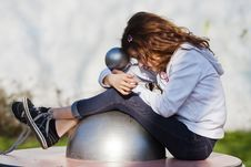 Free Young Girl Dreaming On A Playground Equipment Royalty Free Stock Images - 24087249
