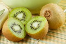 Free Kiwi Sliced And Whole Fruits, Green Bowl Stock Photography - 24095422