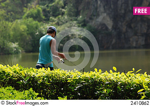 Free Teen Fishing In The Pond Stock Photography - 2410862