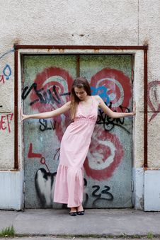 Free Girl Standing At The Door With Graffiti Stock Images - 24102094