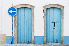 Free Two Blue Doors And Blue Traffic Sign Royalty Free Stock Image - 24102166