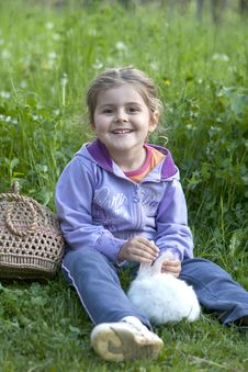 Little Girl With White Rabbit Stock Photo