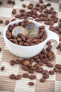 Free Ceramic Cup With Coffee Seed And Euro Coins Royalty Free Stock Image - 24119496