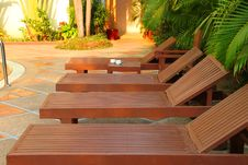 Free Wooden Pool Trestle Beds By The Poolside Royalty Free Stock Photography - 24119717