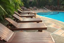 Free Wooden Pool Trestle Beds By The Poolside Stock Image - 24119861
