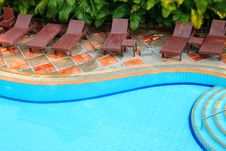 Free Wooden Pool Trestle Beds By The Poolside Royalty Free Stock Image - 24120356