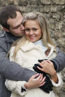 Free Young Woman Smiles In The Arms Of Her Boyfriend Stock Photo - 24123950