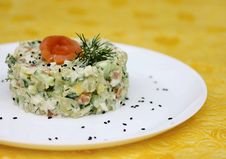 Holiday Salad With Salted Fish And Fresh Cucumber Stock Photography