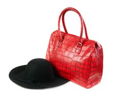Red Fashion Ladies Handbag And A Black Felt Hat