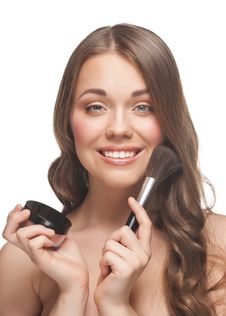 Pretty Woman Applying Makeup Royalty Free Stock Photography