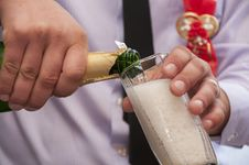 Free Hands Pour Champagne Stock Photo - 24160010