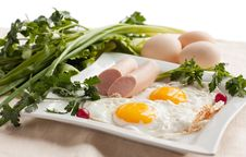 Free Eggs With Sausage And Greens For Breakfast Royalty Free Stock Images - 24162659