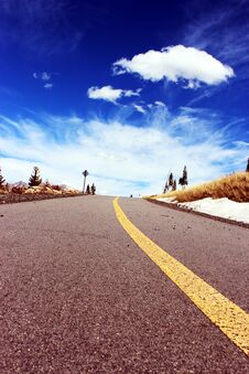 Road With Blue Skies And Clouds Stock Image
