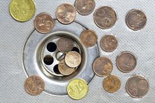 Free Coins Close To Drain Royalty Free Stock Photo - 24165225