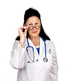 Free Friendly Doctor Looking Over Glasses Stock Image - 24174051