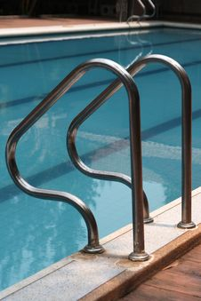 Swimming Pool And Stainless Stairs Royalty Free Stock Photography