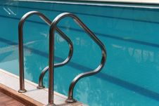 Swimming Pool And Stainless Stairs Royalty Free Stock Image