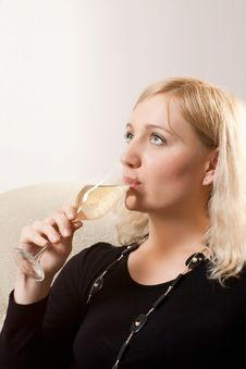 Free Young Beautiful Woman Drinks Wine Royalty Free Stock Image - 24178736
