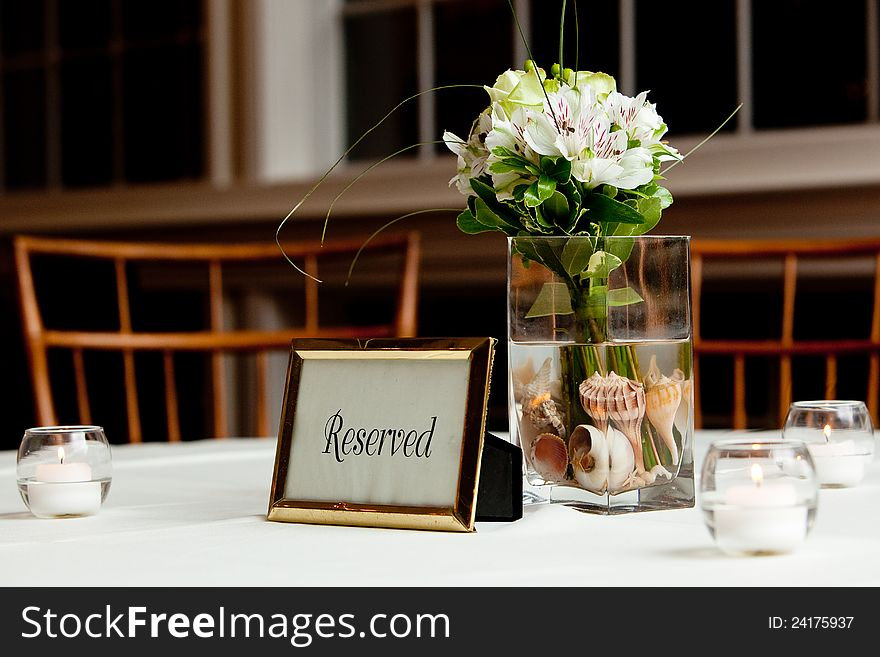 Bouquet of flowers on a reserved table