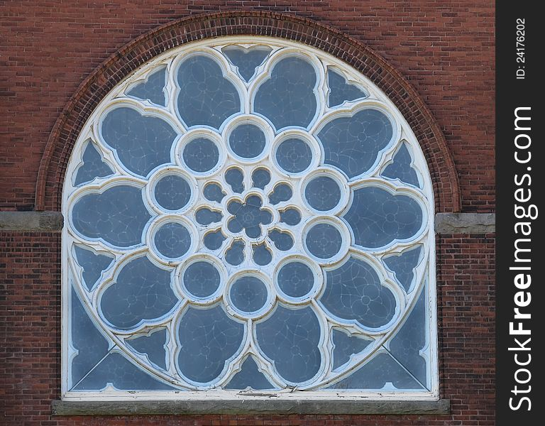 Old blue arched stained glass window