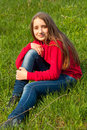 Free Beautiful Teenage Girl Sitting In The Grass Royalty Free Stock Photos - 24188928