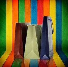 Free Shopping Bags On Colorful Wood Royalty Free Stock Photo - 24186275