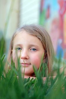 Portrait Of A Girl In The Grass Stock Photo