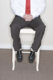 Businessman Sitting In High Ch Stock Images