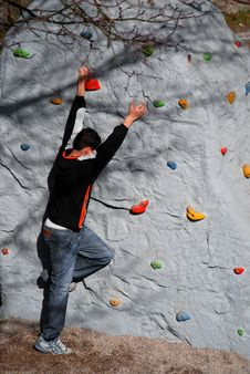 Free Kid Is Climbing Up A Wall Royalty Free Stock Photography - 2424487