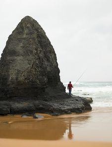 Man Fishing On A Beach Stock Photo