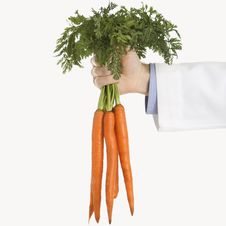 Free Doctor Holding Carrots Royalty Free Stock Photos - 2425998