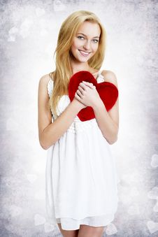 Free Sweet Young Woman Holding Red Heart Pillow Royalty Free Stock Photo - 24200365