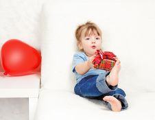 Free Beautiful Girl Holding A Gift Royalty Free Stock Photography - 24215877