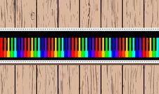 Free Wooden Card With Rainbow Piano. Stock Photos - 24216583
