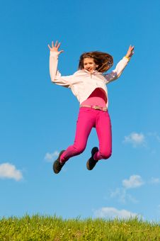 Free Cute Teenage Girl Jumping With Joy Royalty Free Stock Images - 24218089