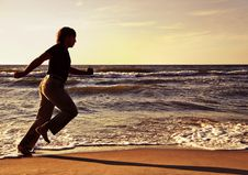 Free Man Running Along Seashore Stock Photos - 24224353