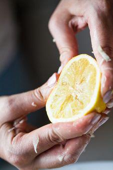 Hand Squeezing Yellow Lemon Stock Photos
