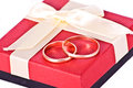 Free Golden Wedding Rings Near The Red Gift Box Stock Image - 24245491