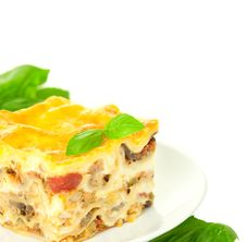 Free Portion Of Classic Lasagna Bolognese With Basil Stock Photos - 24254953