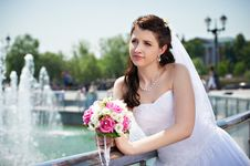 Happy Bride About Fountain With Bouquet Royalty Free Stock Photo